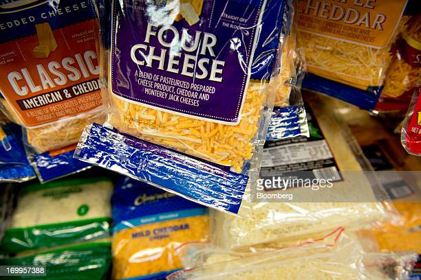 Varieties of shredded cheese sit on display at a supermarket in Princeton Illinois US on Tuesday June 4 2013 The Food and Agriculture Organization of...