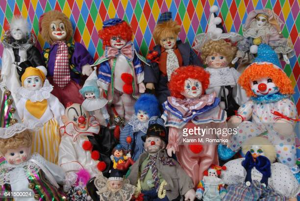 Variety / collage of clowns; clown figurines; multi-colored background