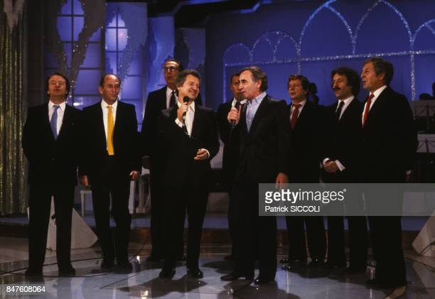 Variety group singers Les Compagnons de la Chanson on set of television program with Charles Aznavour on December 11 1982 in France