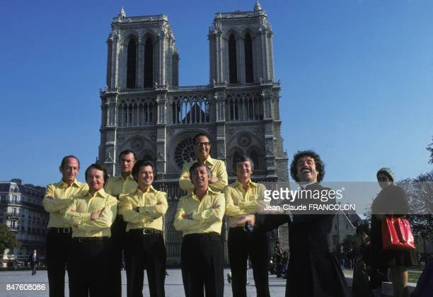 Variety group singers Les Compagnons de la Chanson singing in front of the cathedral NotreDame de Paris in October 1975 in Paris France