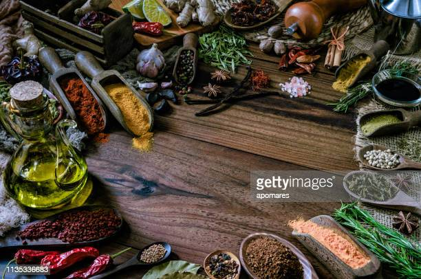 variety of allspice ingredients and condiments for food seasoning on table in old fashioned kitchen - garlic clove imagens e fotografias de stock