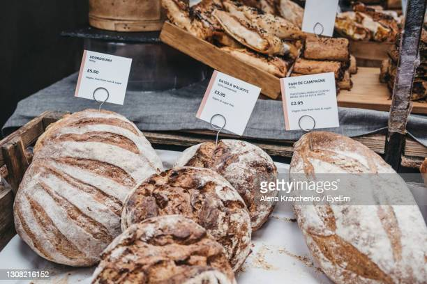 variety of artisan bread on sale at a street market, selective focus. - bread stock pictures, royalty-free photos & images