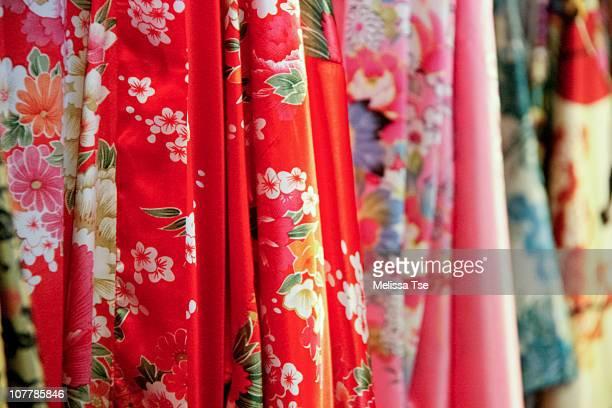Variety of Asian silk robes and kimonos