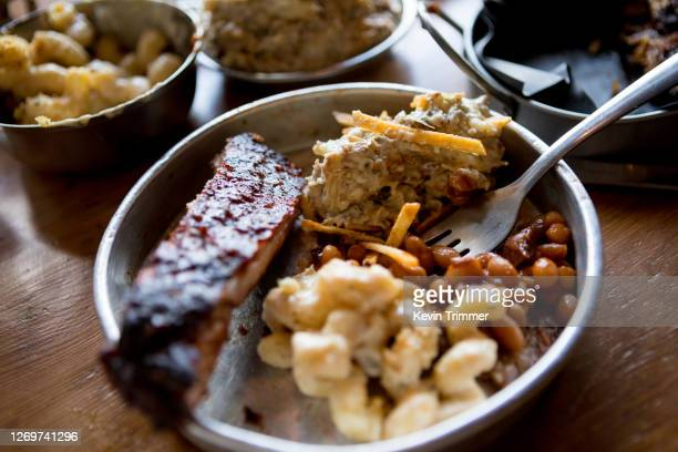 variety of barbecue food with side dishes on table - comfort food stock pictures, royalty-free photos & images