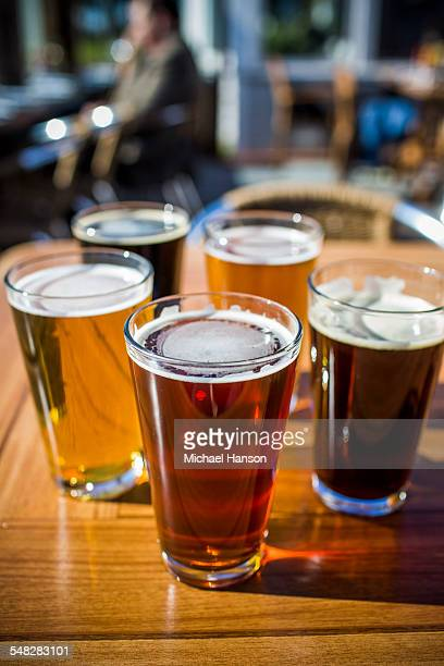 A variety of beers at Half Moon Bay Brewing Company in Half Moon Bay, California on a sunny day.