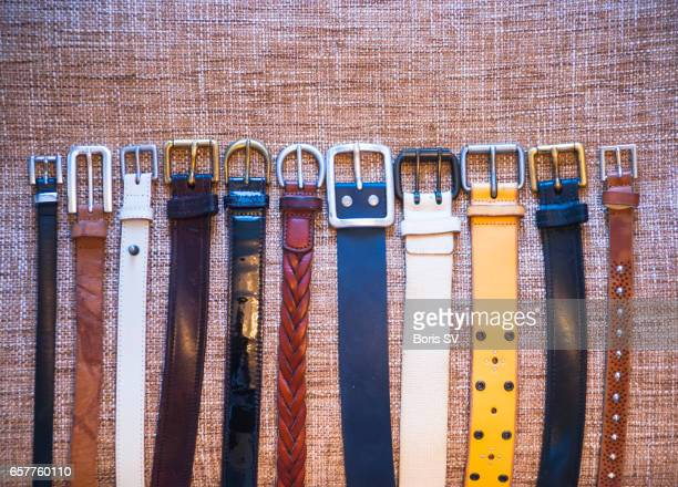 Variety of belts in a row