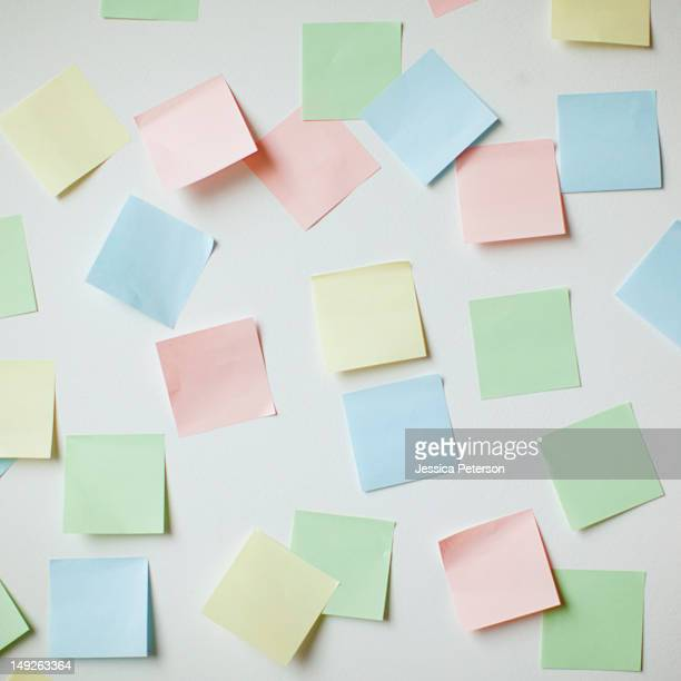 Variety of blank adhesive notes on wall