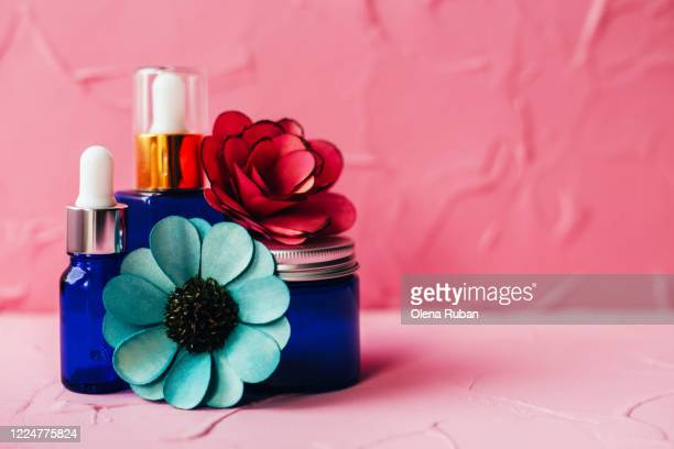 a variety of blue cosmetic packaging with pills and dried flowers - beauty salon ukraine stock pictures, royalty-free photos & images