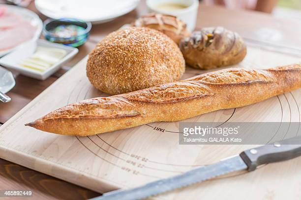 Variety of bread on chopping board