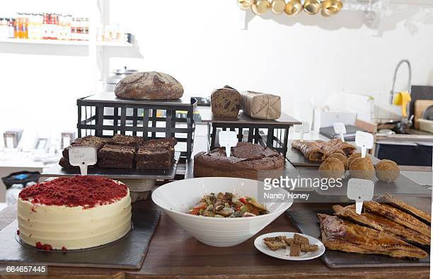 Variety of cakes, pastries and bread on cafe counter
