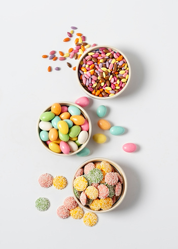 Variety of candy in bowls on white background - gettyimageskorea
