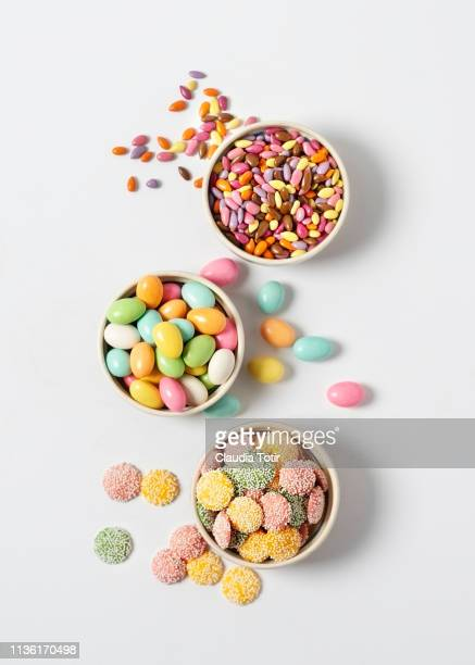 variety of candy in bowls on white background - easter egg stock pictures, royalty-free photos & images