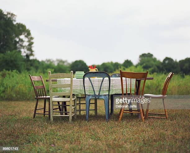 variety of chairs and table - mismatch stock pictures, royalty-free photos & images