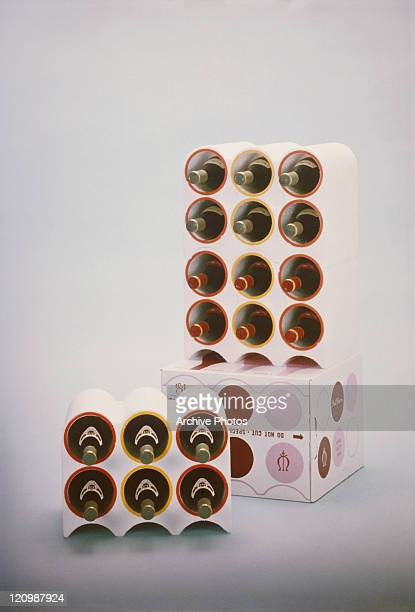 Variety of champagne bottles in six packs box on white background