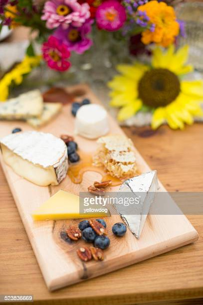 Variety of cheeses on cheese board
