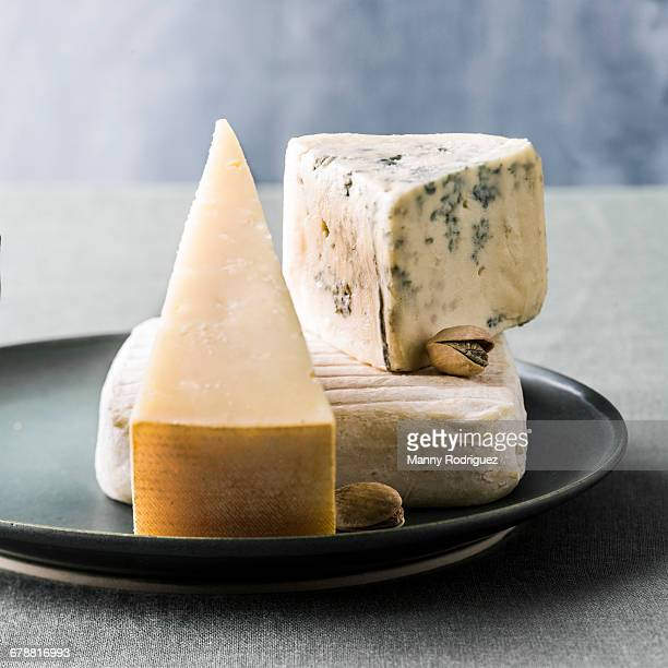 variety of cheeses on plate - artisan stock photos and pictures