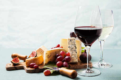 Variety of cheeses on serving board 958364666