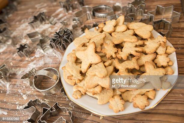Variety of Christmas cookies and pastry cutter on kitchen counter, Munich, Bavaria, Germany