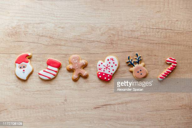 variety of christmas cookies on the wooden table - christmas cookies stock pictures, royalty-free photos & images