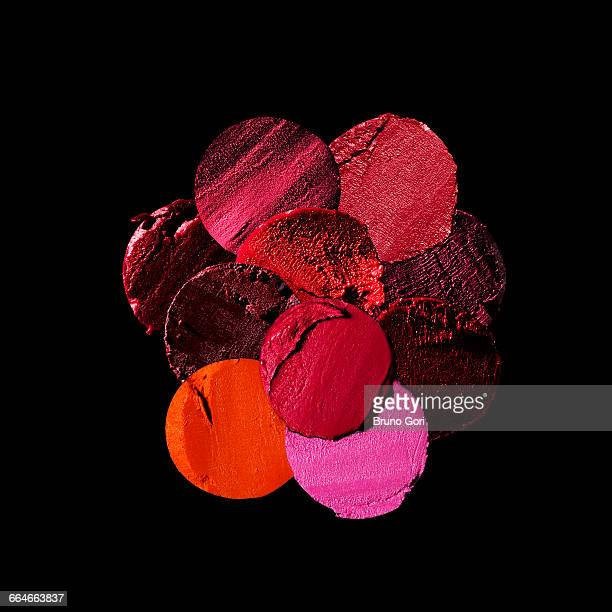 variety of circular lipstick slices against black background - lipstick stock pictures, royalty-free photos & images