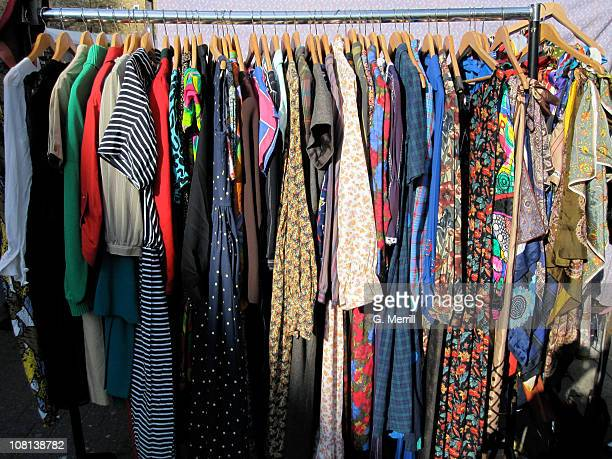 a variety of clothes for sale - clothes rack stock pictures, royalty-free photos & images