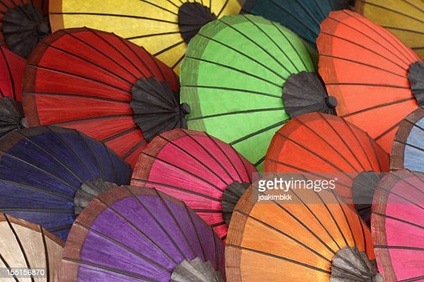 Variety of colorful Asian umbrellas on display
