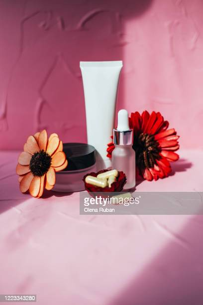 a variety of cosmetic packaging with pills and dried flowers - beauty salon ukraine stock pictures, royalty-free photos & images