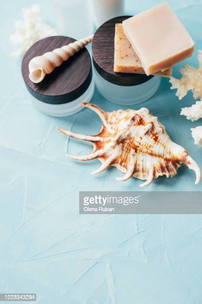 a variety of cosmetic packaging with soap and shells - beauty salon ukraine stock pictures, royalty-free photos & images