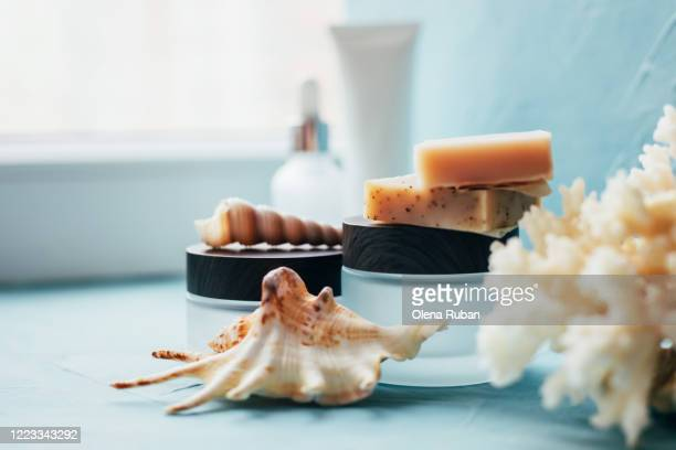 a variety of cosmetic packaging with soap, shells and coral - beauty salon ukraine stock pictures, royalty-free photos & images