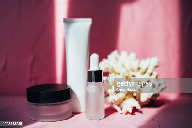 a variety of cosmetic packaging with white coral - beauty salon ukraine stock pictures, royalty-free photos & images