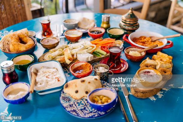 variety of dishes served during traditional turkish breakfast, istanbul, turkey - turkey middle east stock pictures, royalty-free photos & images