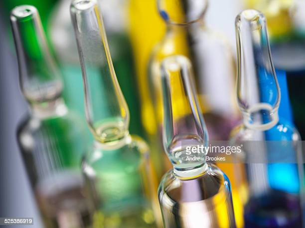 A variety of drug treatments in glass bottles, close-up