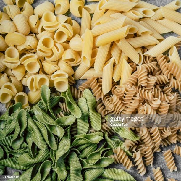 variety of dry pasta - pasta stock pictures, royalty-free photos & images