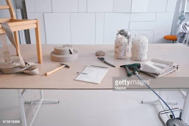 Variety of equipment on desk in design studio