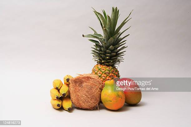 Variety of exotic tropical fruits on a white background.
