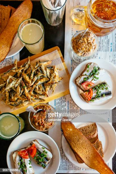 variety of fish snacks with beer and kvas on the table in traditional diner in odessa, ukraine, directly above view - odessa ukraine stock photos and pictures