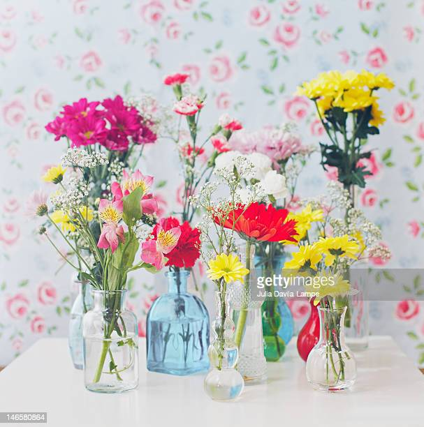 Variety of flowers in bottles