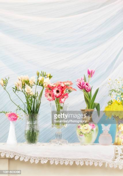 variety of flowers in different vintage and antique vases - tulips and daffodils stock pictures, royalty-free photos & images