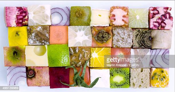 Variety of food in cube shape over white background