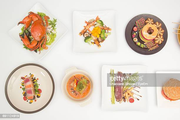 Variety Of Food Served In Plates On Table