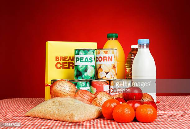 variety of fresh and packaged basic foodstuffs against deep red - generic description stock pictures, royalty-free photos & images