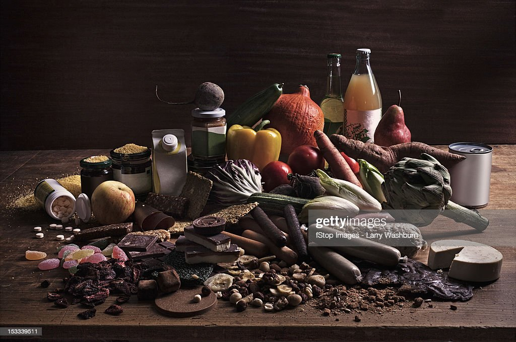 A variety of fresh and processed foods in a heap on a table : Stock-Foto