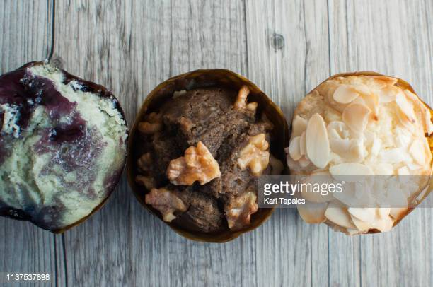 Variety of freshly baked muffins on a rustic wooden table