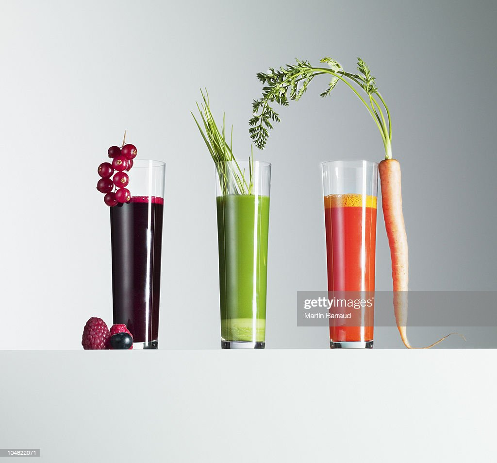 Variety of fruit and vegetable juices : Stock Photo