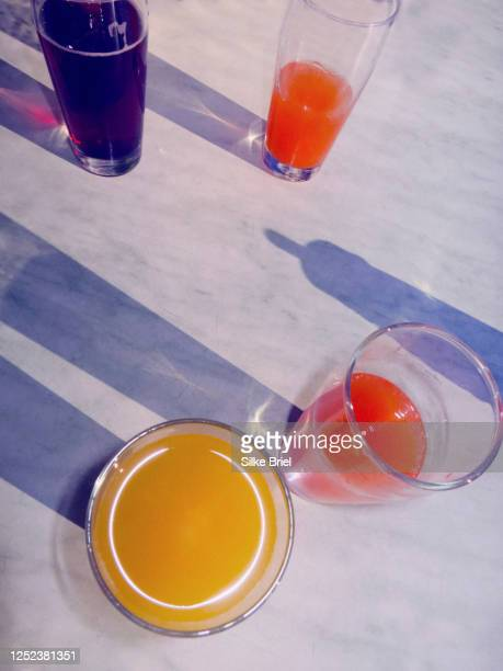 variety of fruit juices in glasses on table - briel stock pictures, royalty-free photos & images