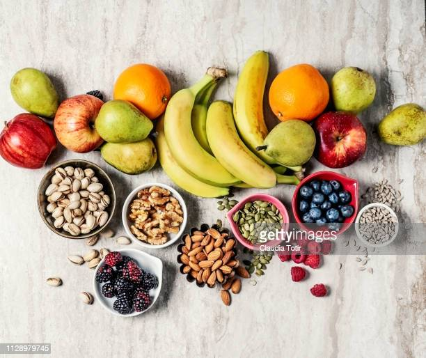 variety of fruits and nuts - gezonde voeding stockfoto's en -beelden