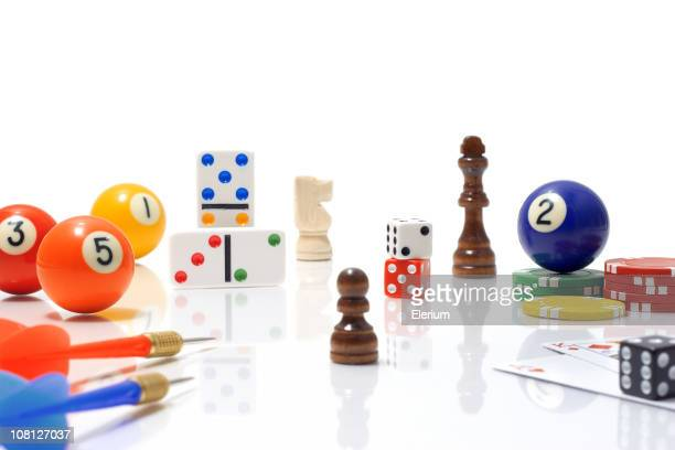 variety of game pieces on white background - game board stock photos and pictures