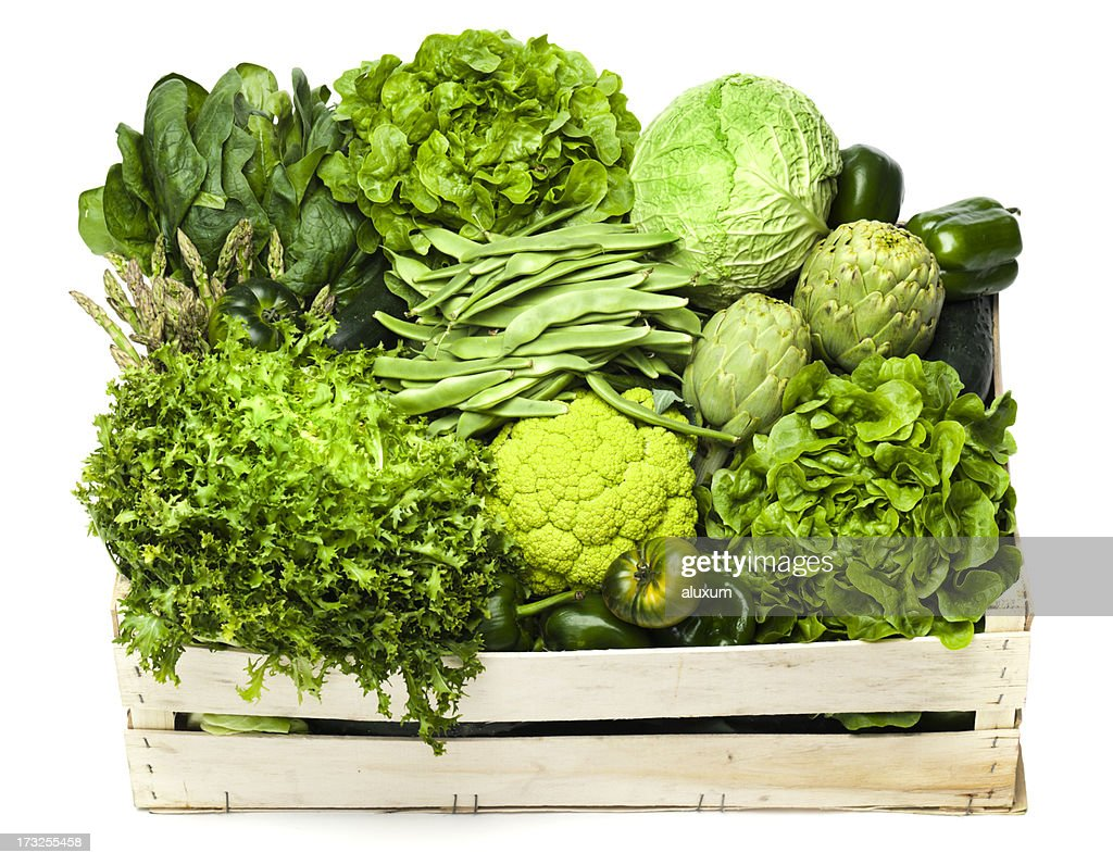 Variety of green vegetables sitting in a wooden box : Stock Photo