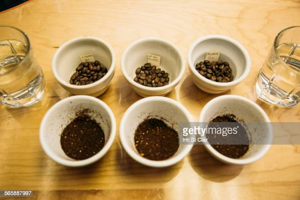 Variety of ground coffee beans in cups