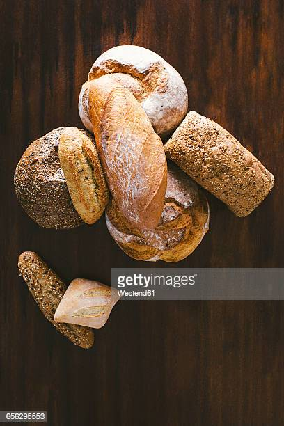 Variety of hand made breads, seeds bread, integral, load bread and rustic on wood